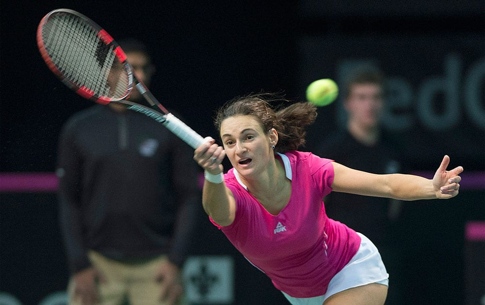 Serbia`s Vesna Dolonc returns the ball to Canada`s Eugenie Bouchard during a Federation Cup tennis match in Montreal.