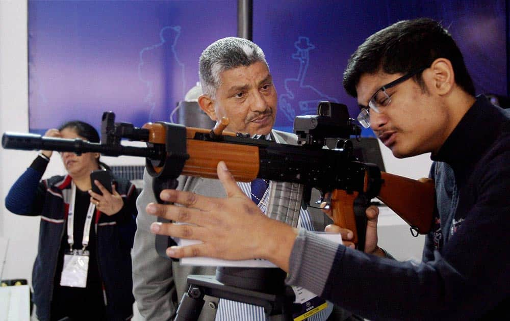 A student learning to operate a weapon at the DefExpo in New Delhi.