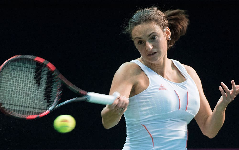 Serbia`s Vesna Dolonc returns the ball to Canada`s Aleksandra Wozniak during a Federation Cup tennis match in Montreal.