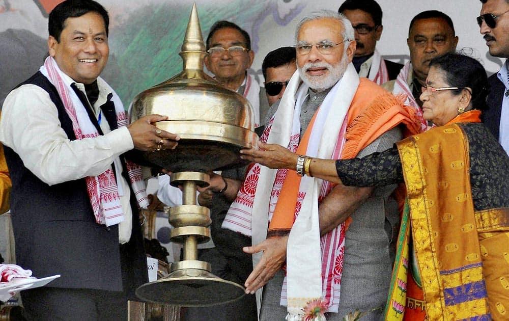 BJP Prime Ministerial candidate Narendra Modi is presented a `Khoria` during the `Mahajagaran Rally` in Guwahati.