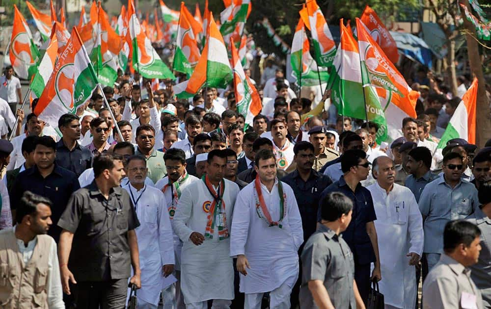 India's ruling Congress Party Vice President Rahul Gandhi, center right, walks during Vikas Khoj Yatra, or Development Search March, in Bardoli, south of the western Indian state of Gujarat.