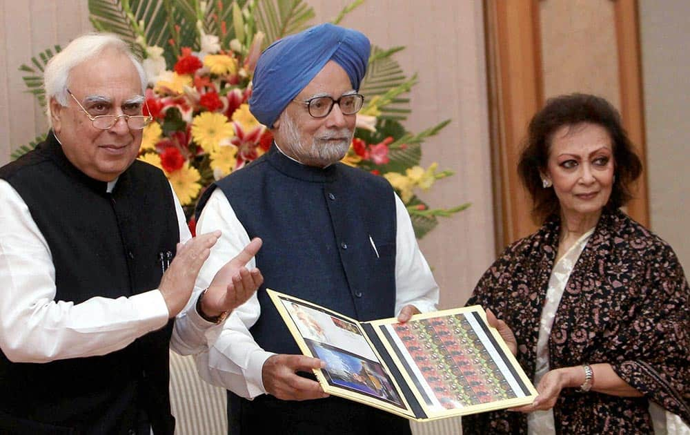 Prime Minister Manmohan Singh releases commemorative postage stamps on legendary singer Jagjit Singh on his birth anniversary in New Delhi.