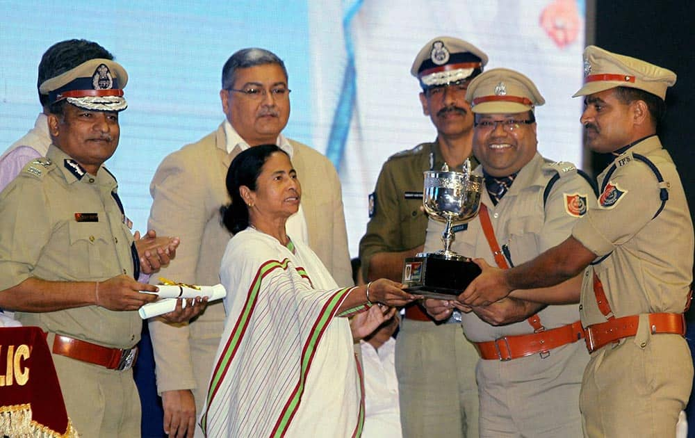 West Bengal Chief Minister Mamata Banerjee presents medal to police officers at West Bengal Police Award Function in Kolkata.