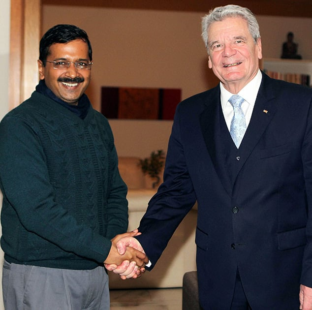 German President Joachim Gauck shakes hands with Delhi Chief Minister Arvind Kejriwal at a meeting in New Delhi.