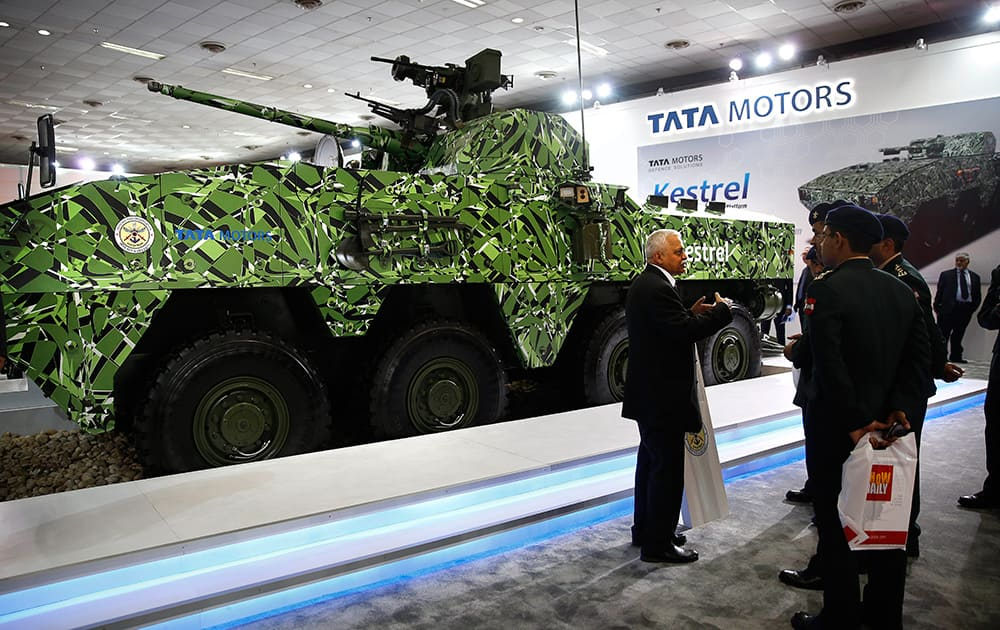 A Tata Motors company exhibitor explains to a group of Indian army personnel about the newly launched Kestrel, a multi-wheeled armored amphibious vehicle, at the 8th International Land and Naval Defense System exhibition, in New Delhi.
