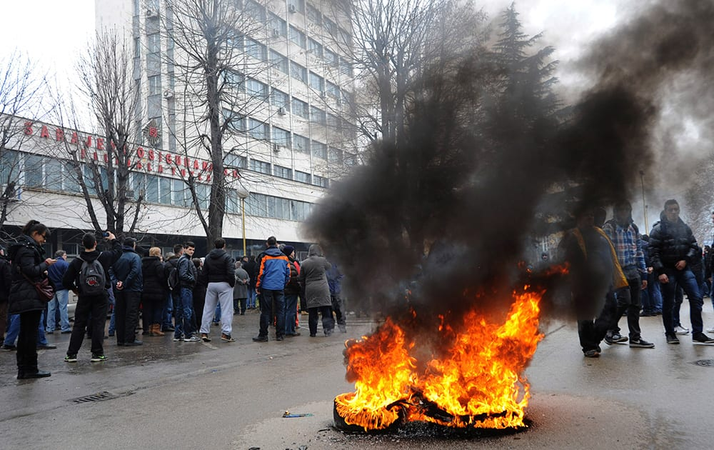 A tyre burns in the street as protesters stoned a local government building in the Bosnian town of Tuzla, 140 kms north of Sarajevo.