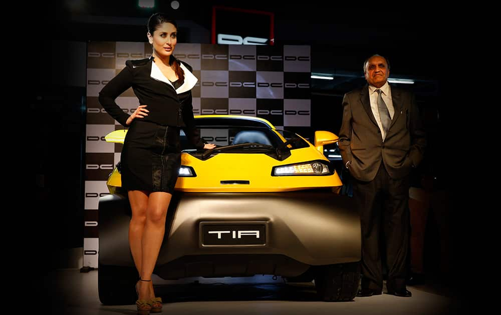 Kareena Kapoor poses with Dilip Chabria during the launch of Tia, a car designed by Chabria, at the 12th Indian auto Expo in Noida.