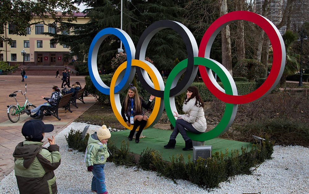 Russian women pose for snapshots next to Olympic rings in Sochi, Russia. The opening ceremony for the 2014 Winter Olympics will be held on Feb. 7, and the competition will run until Feb. 23.