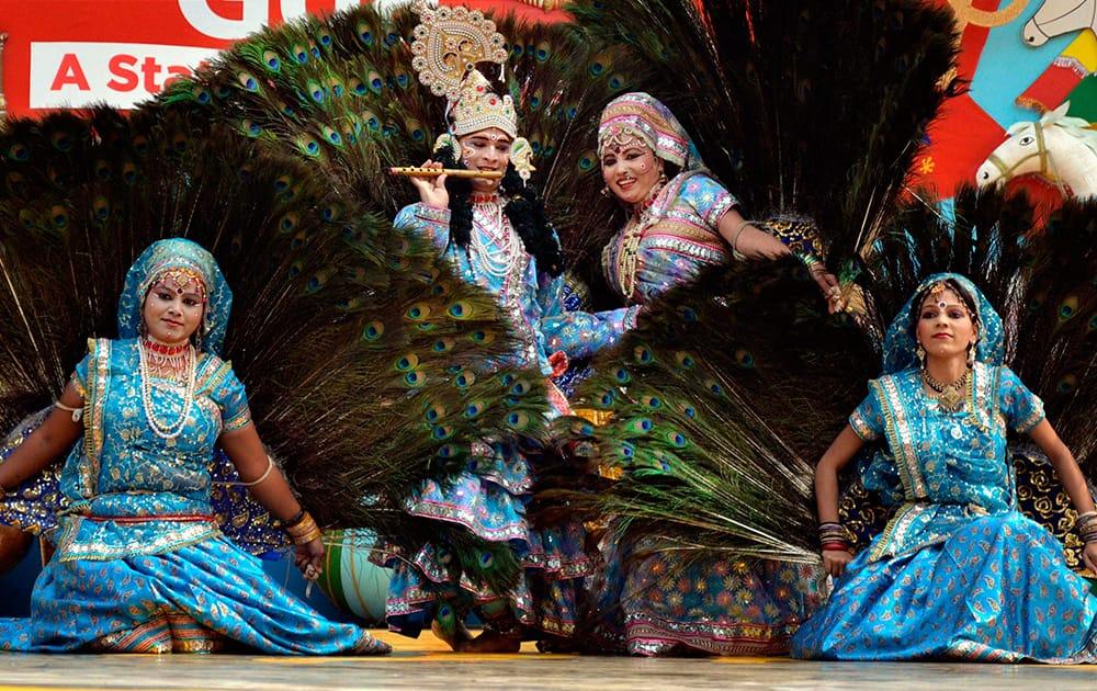 Brij artists perform during 28th Surajkund International Crafts Mela in Faridabad.