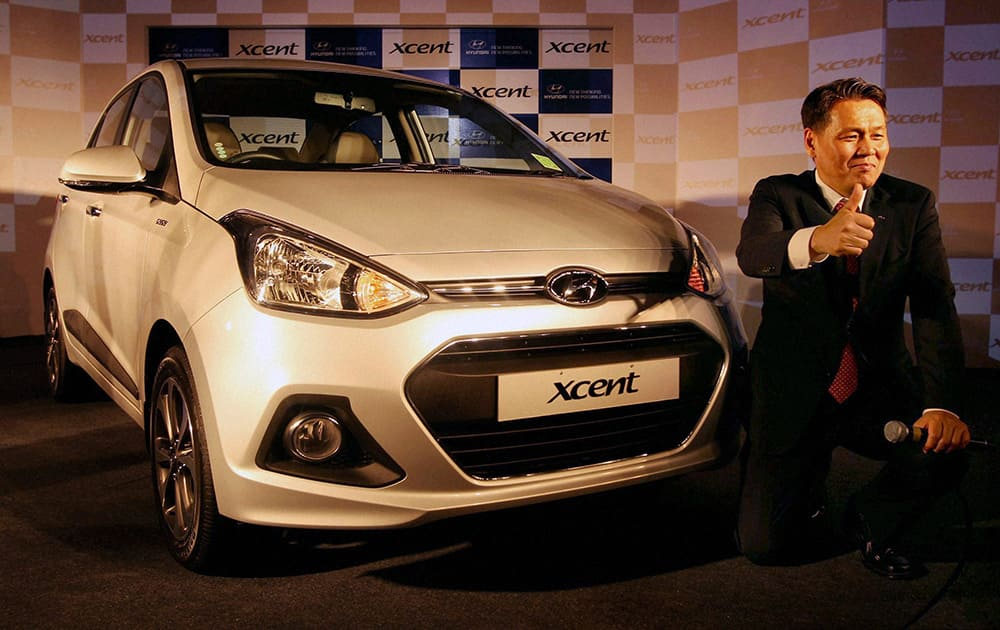 Managing Director & CEO Hyundai Motor India Limited, B.S. Seo at the launch of the new `Xcent` sedan in New Delhi.