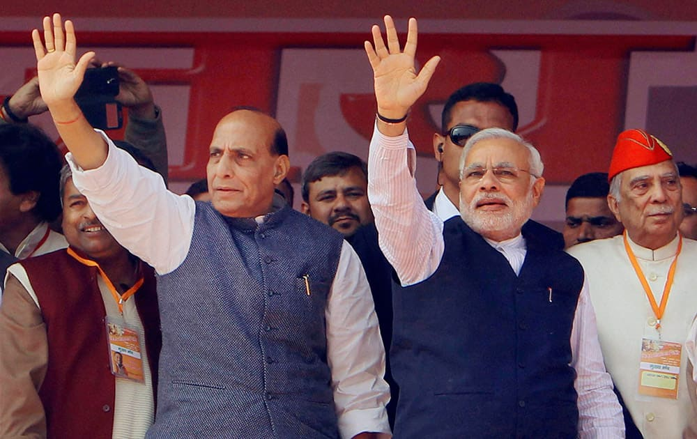 BJP Prime Ministerial Candidate Narendra Modi with Party President Rajnath Singh at the Vijay Shankhnaad rally in Meerut.