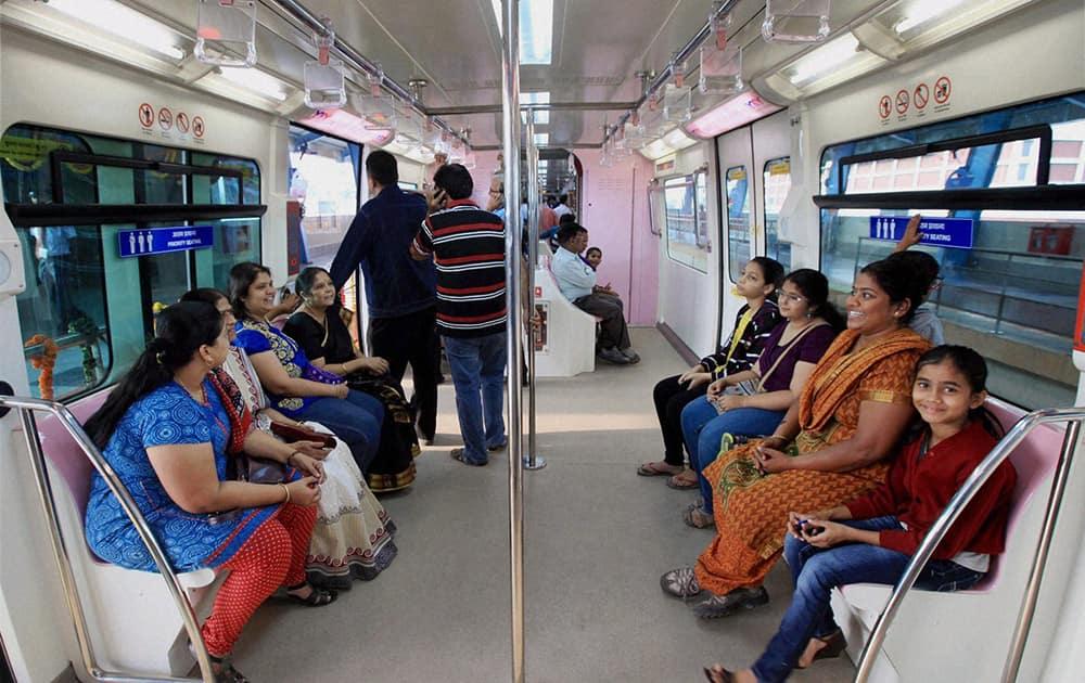 People enjoying first ride of Monorail in Mumbai.