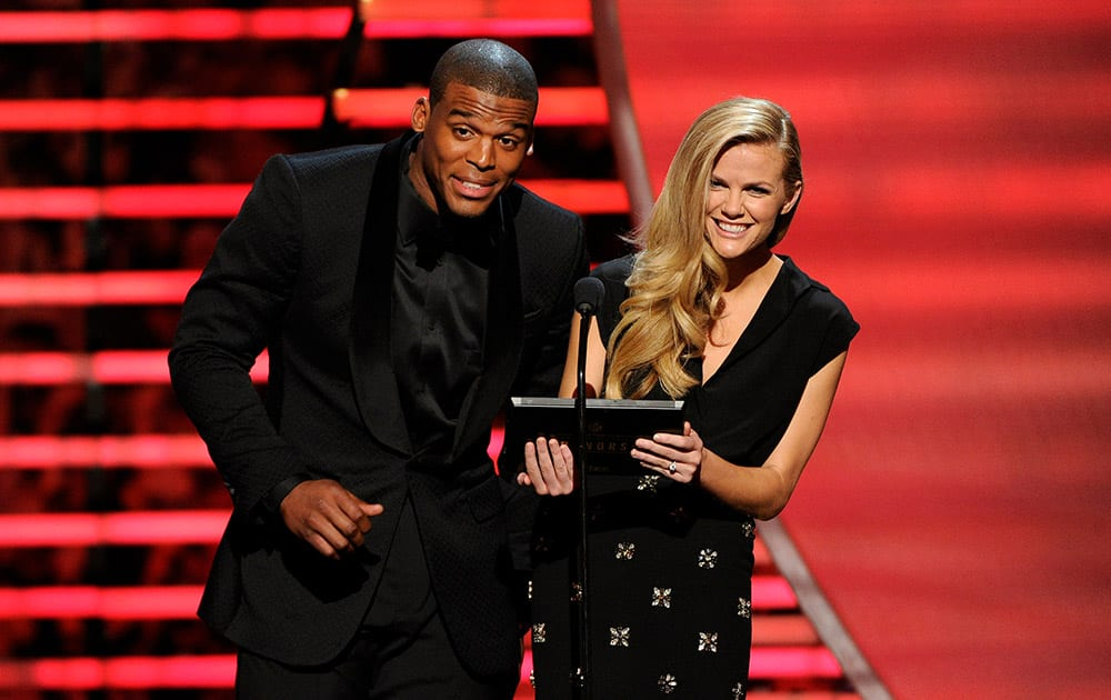 Carolina Panthers` Cam Newton, left, and model Brooklyn Decker speak on stage at the thirrd annual NFL Honors at Radio City Music Hall  in New York.