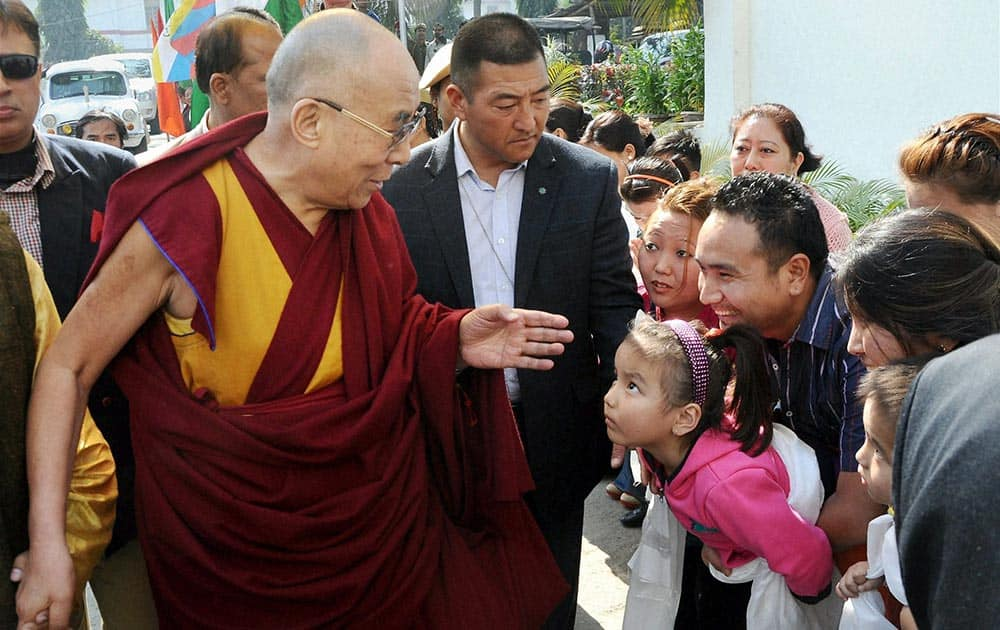 Tibetan spiritual leader the Dalai Lama is welcomed on his arrival for a programme in Guwahati, Assam.