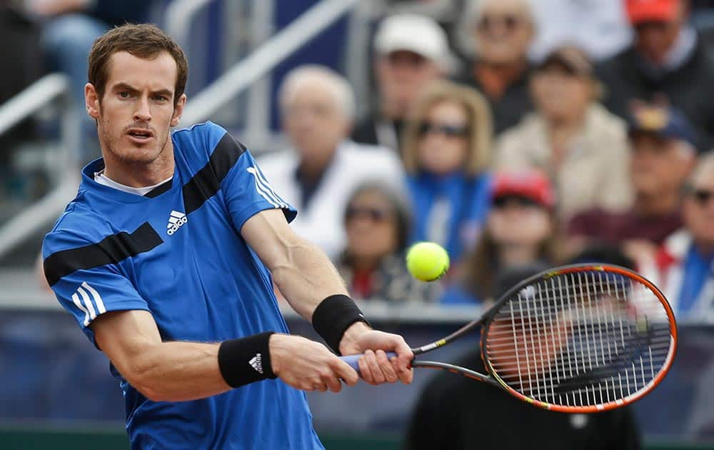 Britain`s Andy Murray hits a backhand return during his 6-1, 6-2, 6-3 victory over Donald Young, of the United States, in a Davis Cup tennis match.
