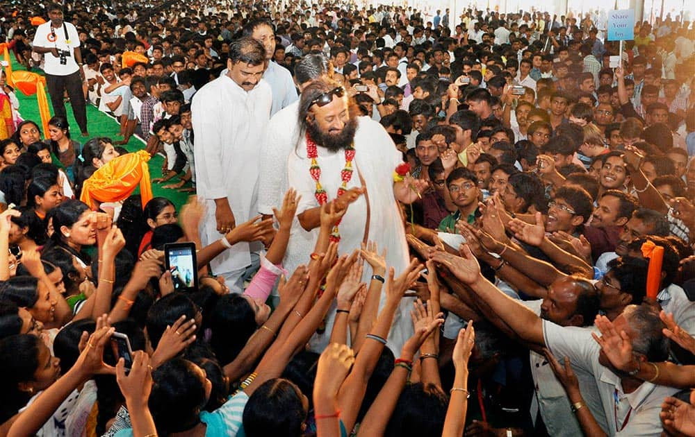 Sri Sri Ravi Shankar, founder of Art of Living Foundation, interacting with students in Coimbatore.