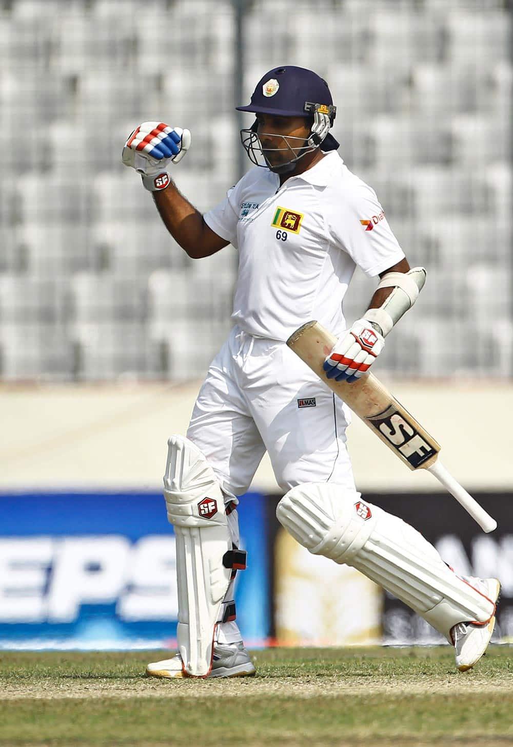 Sri Lanka`s Mahela Jayawardene celebrates after scoring a century on the third day of the first test cricket match against Bangladesh in Dhaka, Bangladesh.