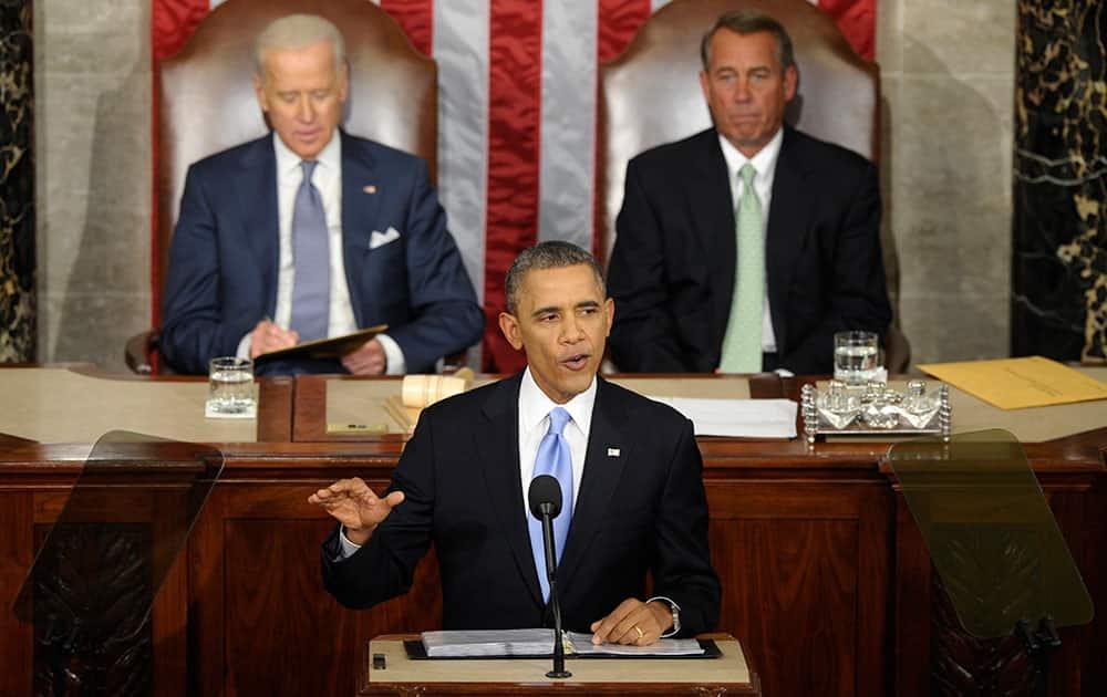 Vice President Joe Biden and House Speaker John Boehner of Ohio listen as President Barack Obama gives his State of the Union address on Capitol Hill in Washington.