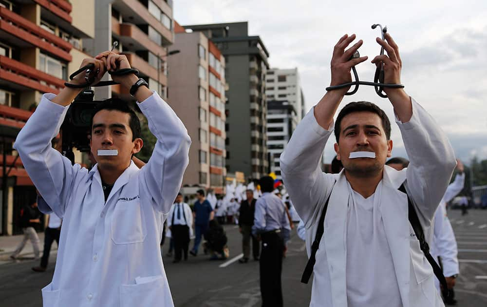 Doctors and medical students protest against a new law criminalizing medical malpractice in Quito, Ecuador.