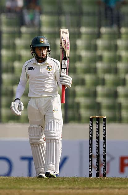 Bangladesh's captain Mushfiqur Rahim acknowledges the crowd after scoring fifty runs during the first day of the first test cricket match against Sri Lanka, in Dhaka, Bangladesh.