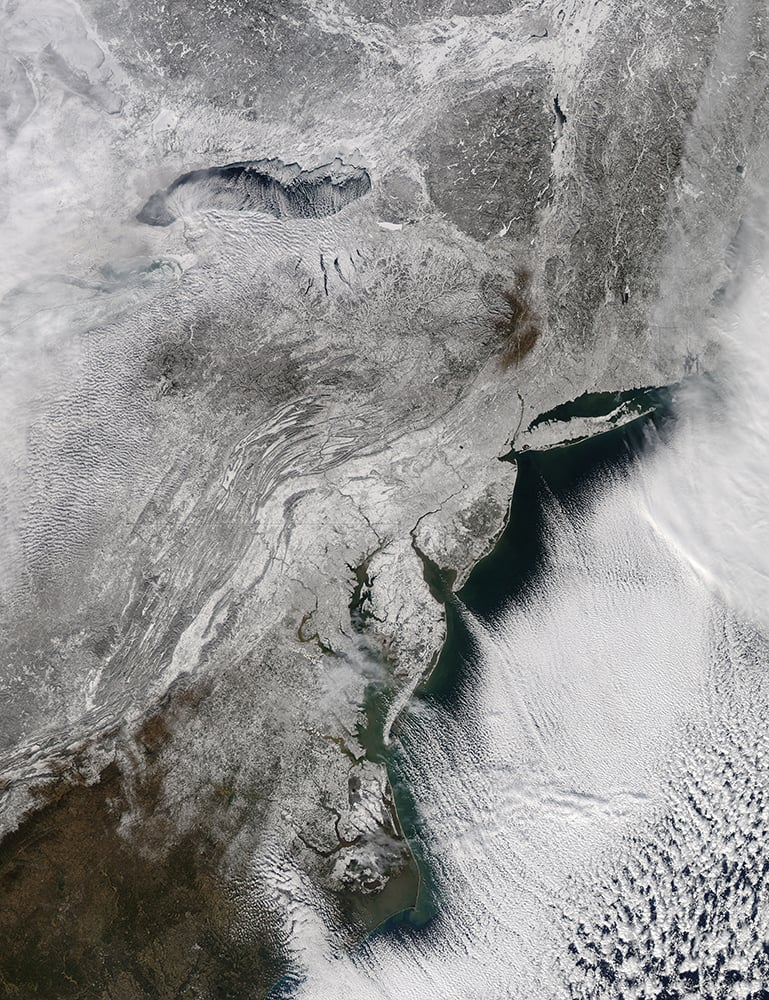 This image provided by NASA shows the snow across the northeastern US taken by NASA`s Aqua satellite.