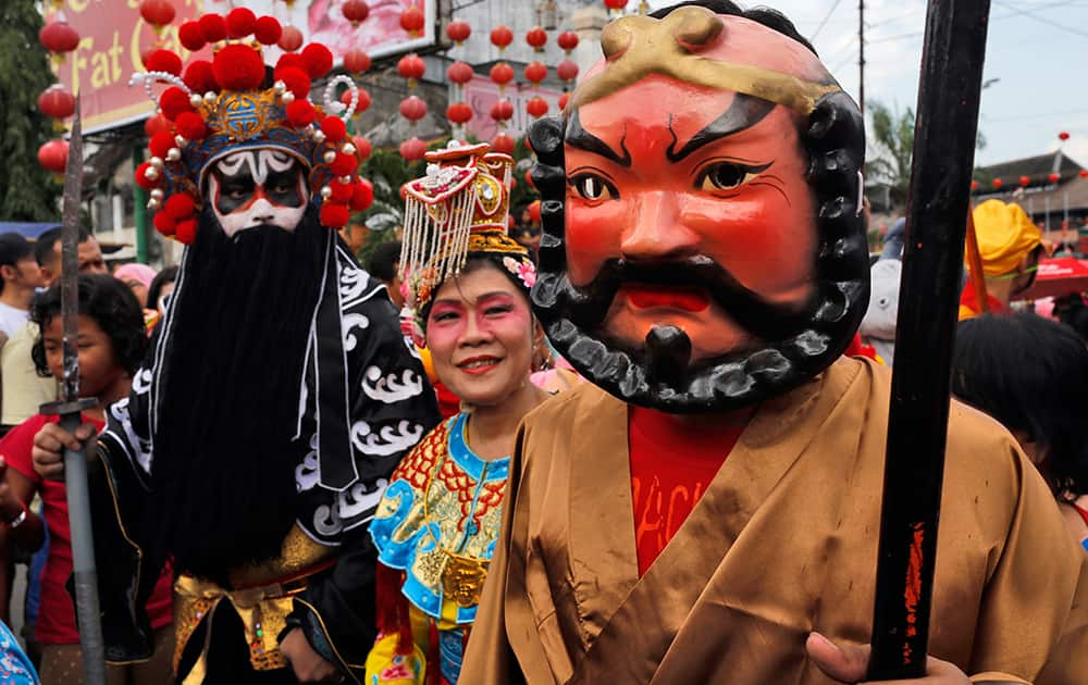 Participants dressed as Chinese gods take part in a traditional parade called `Grebeg Sudiro` to celebrate the upcoming Chinese New Year at the China town in Solo, Central Java, Indonesia.