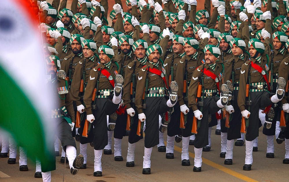 Soldiers march during the Republic Day parade in New Delhi.