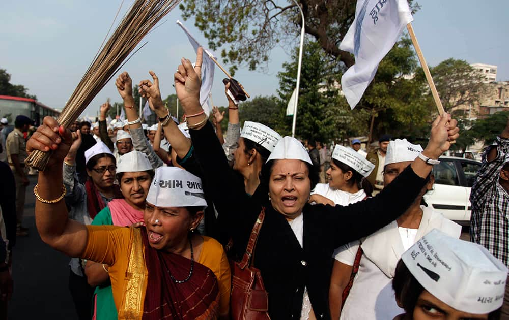 Supporters of India`s Aam Admi, or Common Man`s, party, shout slogans carrying broom, the party symbol, as they march towards Gandhinagar, ahead of the death anniversary of Mahatma Gandhi in Ahmedabad.