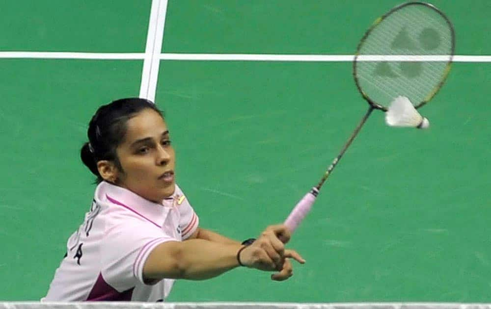 Saina Nehwal in action against Xuan Deng of China during their semi-final of the Syed Modi Inaternational Grand Prix Gold badminton Championship in Lucknow.