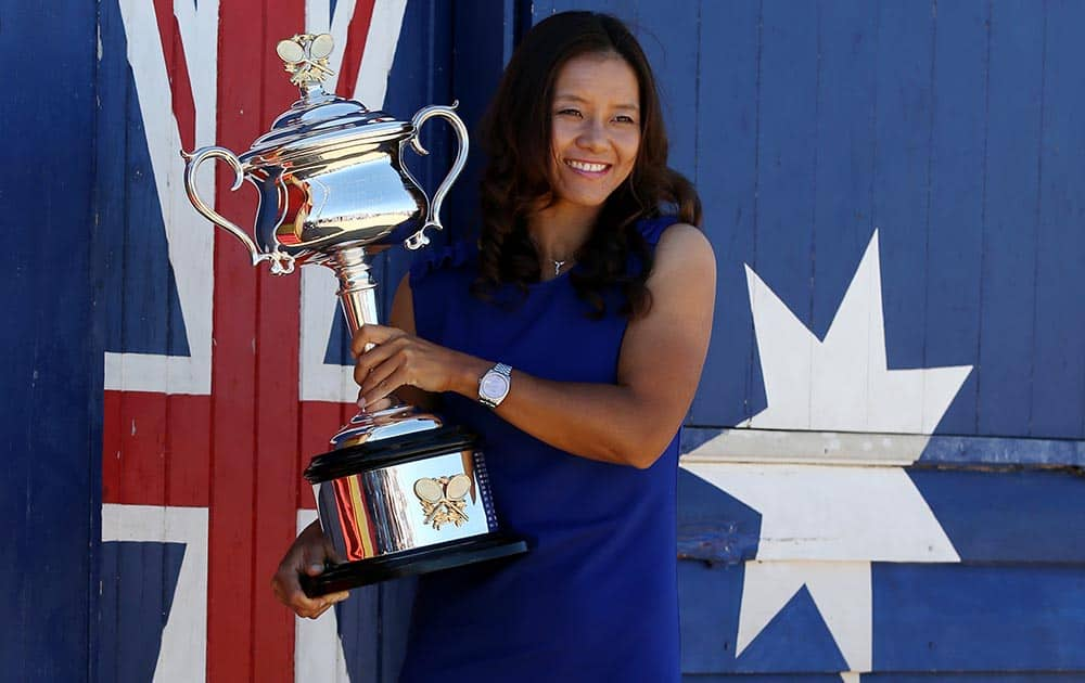 China`s Li Na poses for photos at Brighton Beach with her Australian Open trophy following her win over Slovakia`s Dominika Cibulkova in Melbourne.