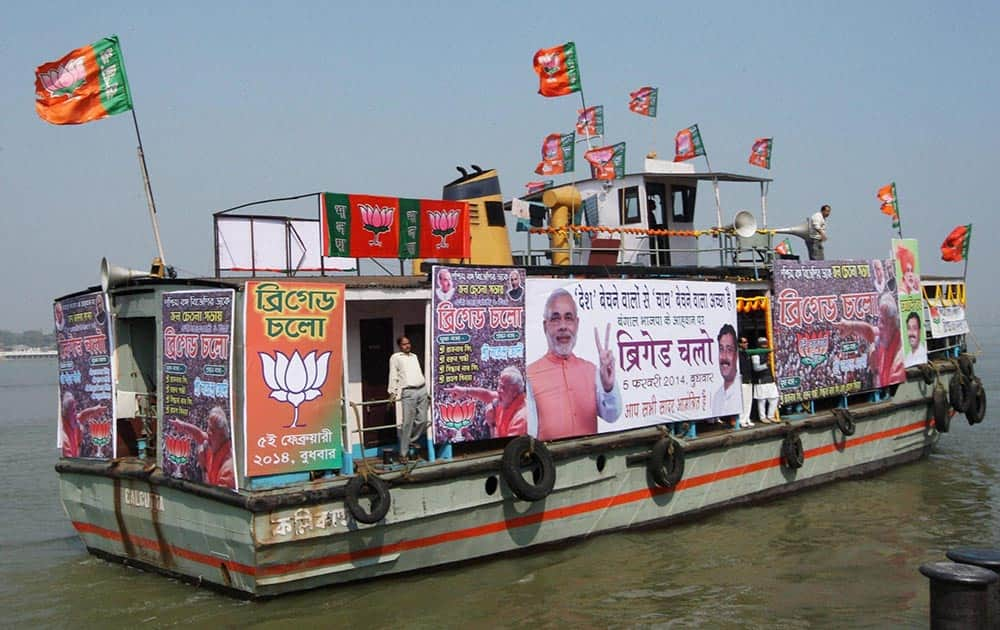 BJP activists campaign on River Ganges in Kolkata on Saturday for the upcoming Kolkata rally of BJP Prime Ministerial candidate Narendra Modi.