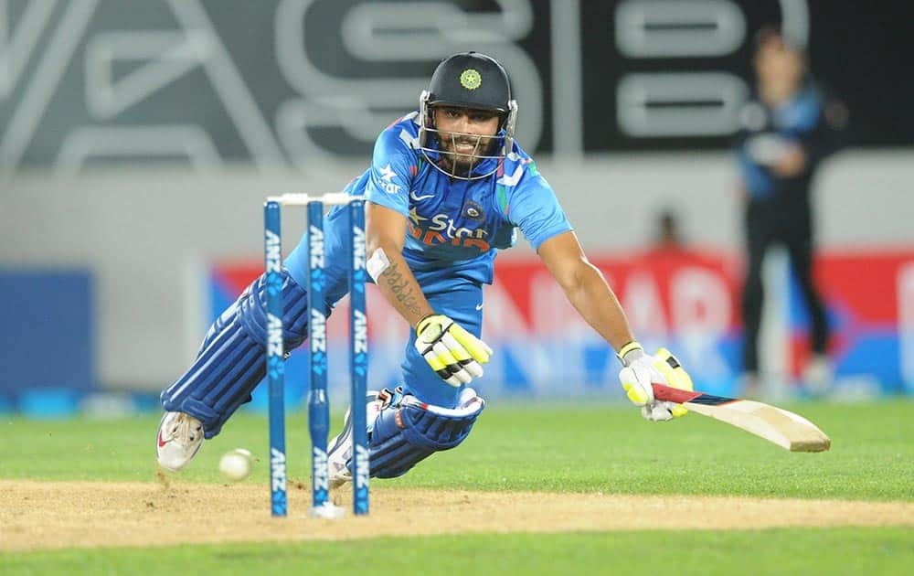 Ravindra Jadeja dives to make his ground against New Zealand during the third one day International cricket match at Eden Park in Auckland, New Zealand.