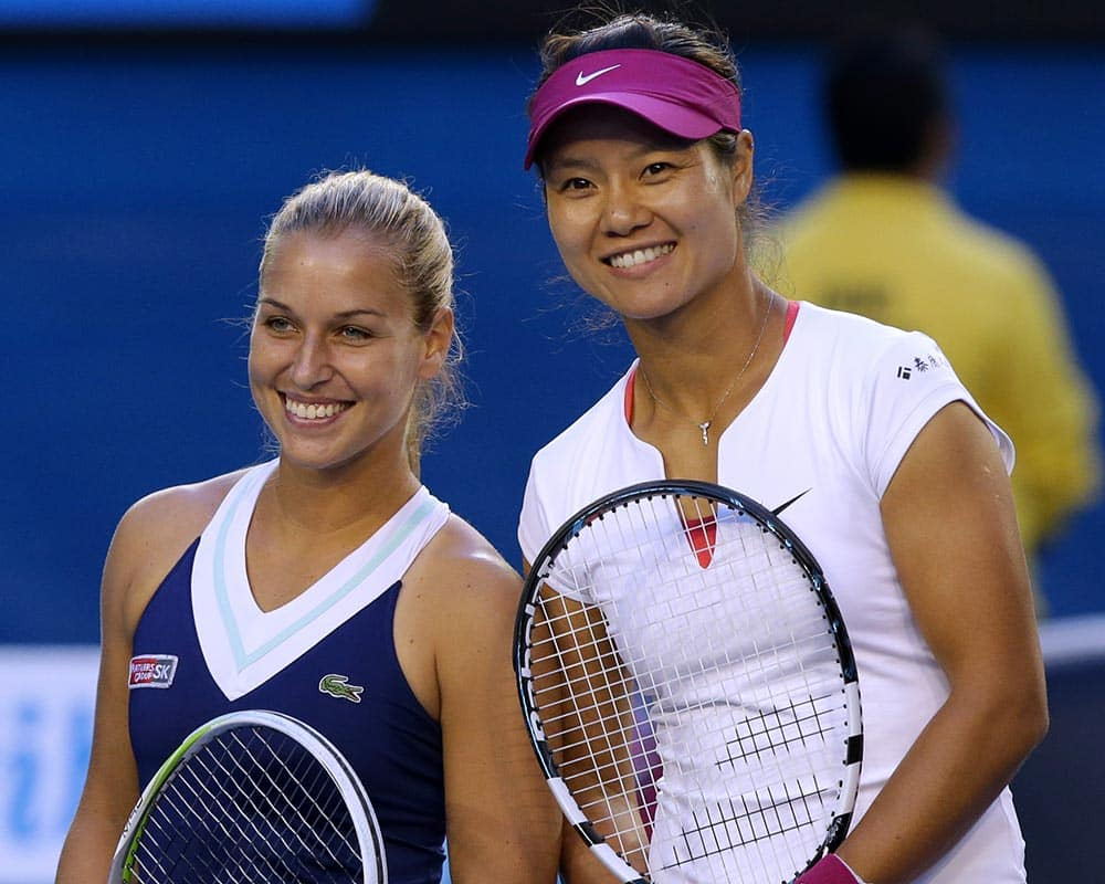 Li Na of China and Dominika Cibulkova of Slovakia pose for a photo at the net, prior to their women`s singles final at the Australian Open tennis championship in Melbourne.