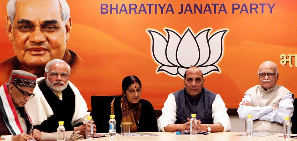 BJP President Rajnath Singh with Gujarat Chief Minister and BJP`s PM candidate Narendra Modi, senior leaders LK Advani, Sushma Swaraj and Murli Manohar Joshi during the party`s Central Election Committee meeting at party headquarters in New Delhi.
