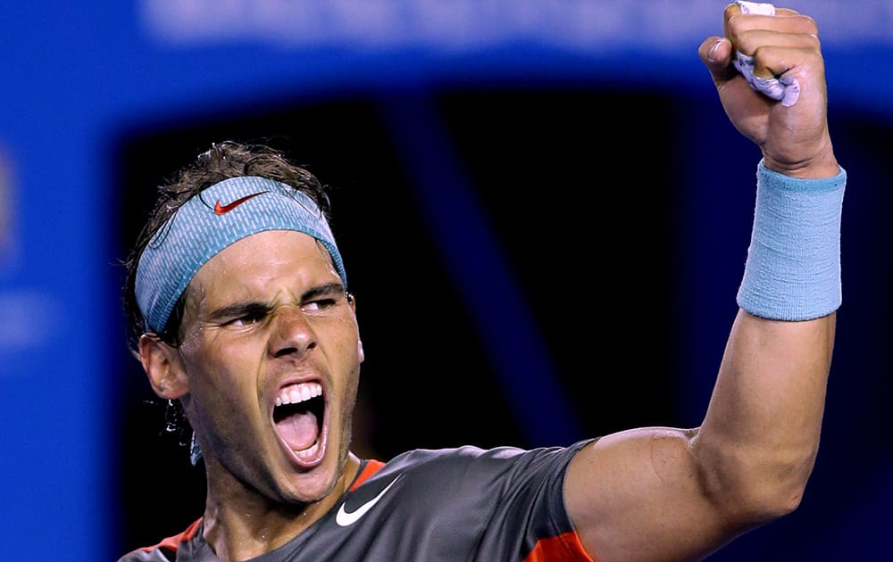 Rafael Nadal of Spain celebrates after defeating Roger Federer of Switzerland during their semifinal at the Australian Open tennis championship in Melbourne, Australia.
