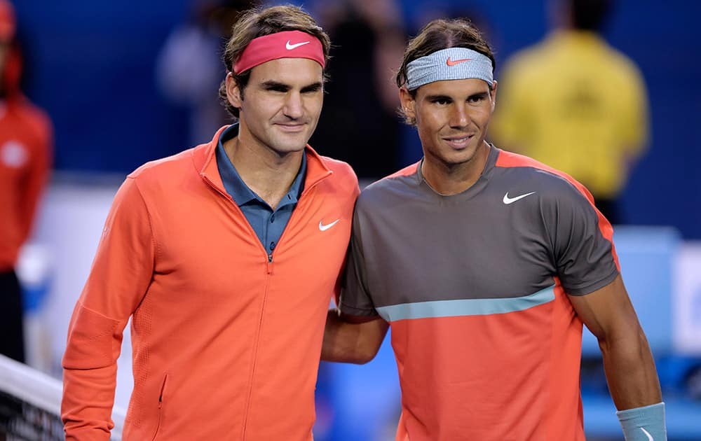 Rafael Nadal of Spain, right, and Roger Federer of Switzerland pose at the net before their semifinal at the Australian Open tennis championship in Melbourne, Australia.