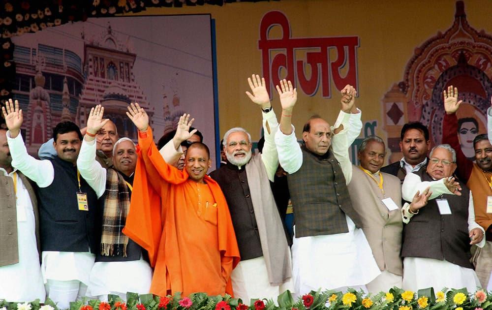 BJP Prime Ministerial candidate Narendra Modi with party President Rajnath Singh, Kalyan Singh and MPs Yogi Adityanath and Kalraj Mishra waves at crowd during a rally at Gorakhpur in Uttar Pradesh.