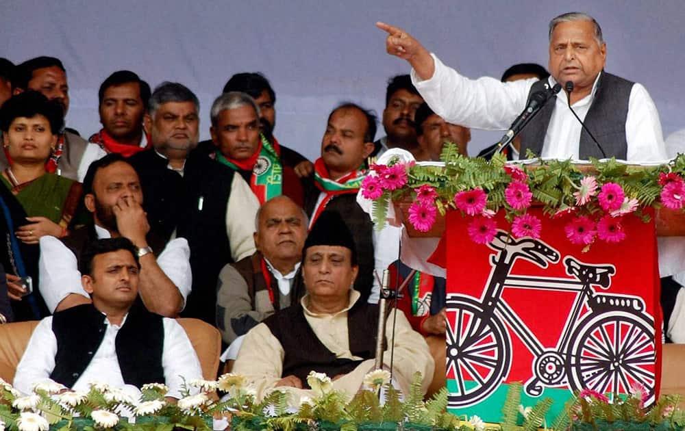 Samajwadi Party supremo Mulayam Singh Yadav addresses a public meeting in Varanasi on Thursday. UP CM Akhilesh Yadav and party leader Azam Khan are also seen.
