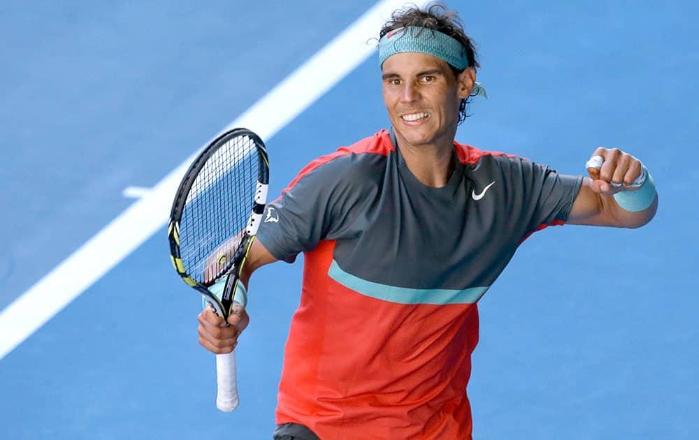 Rafael Nadal of Spain celebrates after defeating Grigor Dimitrov of Bulgaria during their quarterfinal at the Australian Open tennis championship in Melbourne, Australia.