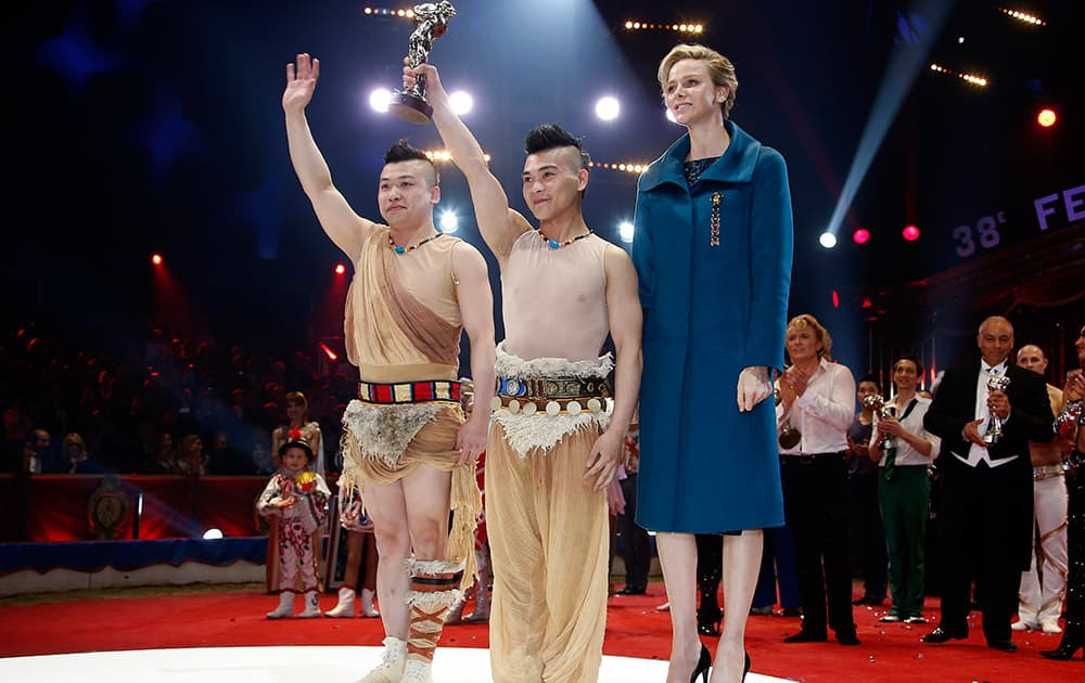Chinese equilibrist duo of the Suining troupe pose with Princess Charlene of Monaco, right, after receiving a Bronze clown during the Award Gala evening of the 38th International Circus Festival of Monte Carlo in Monaco.