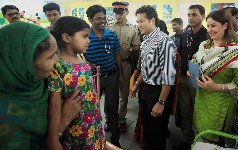 Sachin Tendulkar with his wife Anjali during a promotional event in Mumbai.