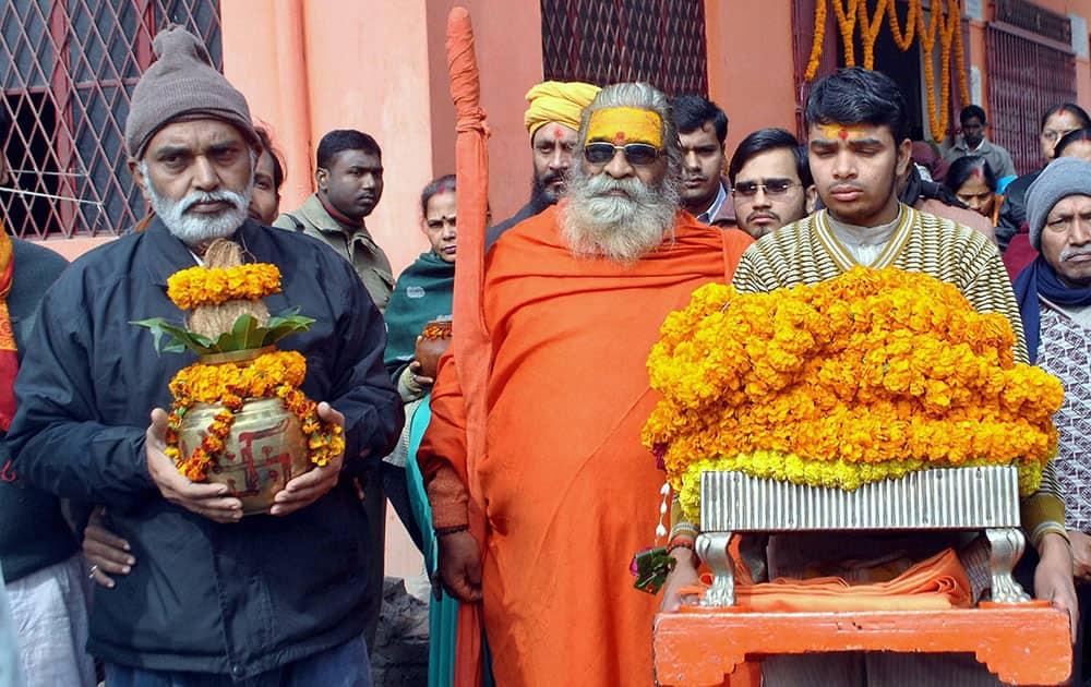 Dandi Swami Shankaracharya Vasudevanand Saraswati takes part in religious procession.