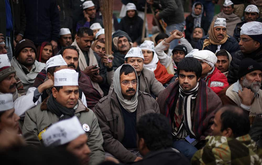 New Delhi Chief Minister Arvind Kejriwal, center, takes part in a protest rally against the police for the second consecutive day, in New Delhi.