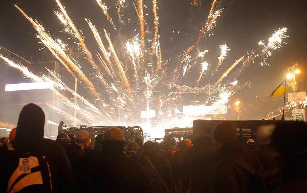 Protesters fire at police with fireworks, in central Kiev, Ukraine.