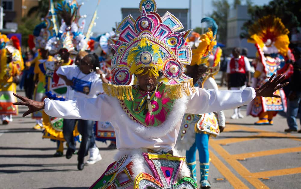 A member of a Caribbean carnival dance group marches in the MLK parade in Miami. Dr. Martin Luther King, Jr. is honored across the country annually on the third Monday in January with Martin Luther King, Jr. Day. He was the most visible figure in the Civil Rights movement.