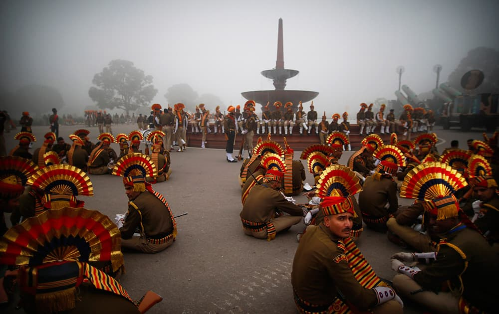 Indian soldiers wait before the beginning of rehearsals for the Republic Day parade early in the morning in New Delhi.
