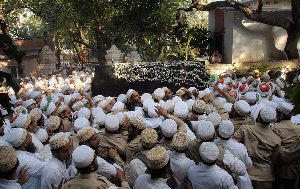 Bohra community`s members participate in funeral procession of spiritual leader Syedna Mohammed Burhanuddin, in Mumbai.