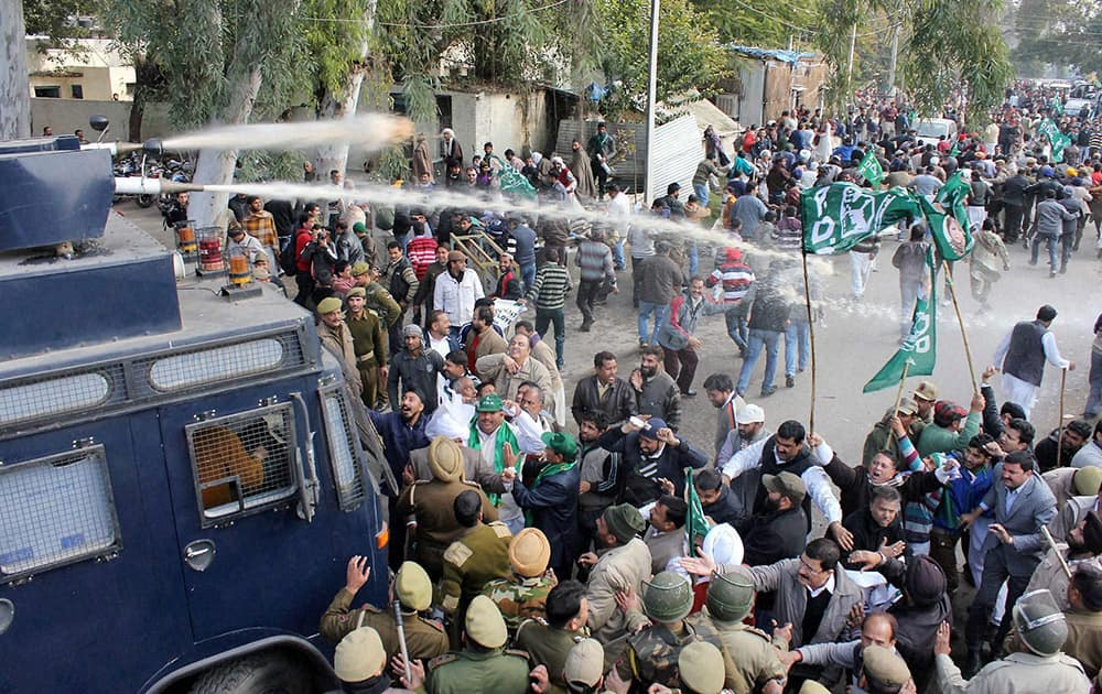 Police use water cannons to disperse PDP activists over holding a protest against state government in Jammu.