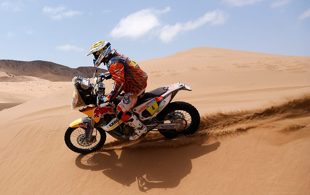 KTM rider Jordi Viladoms of Spain rides his motorcycle on the dunes during the twelfth stage of the Dakar Rally between the cities of El Salvador and La Serena, Chile.
