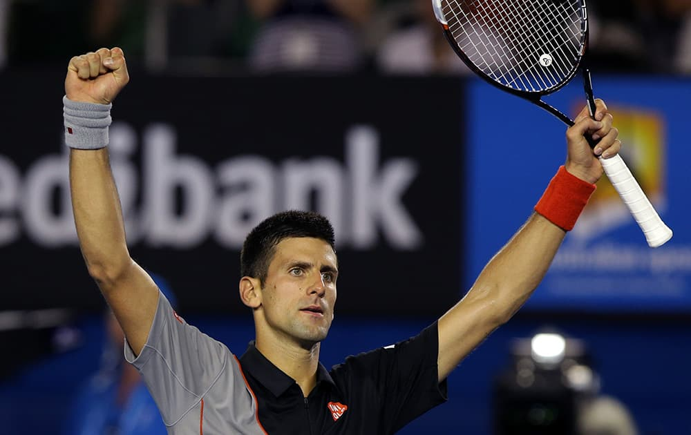 Novak Djokovic of Serbia celebrates after his win over Denis Istomin of Uzbekistan during their third round match at the Australian Open tennis championship in Melbourne, Australia.
